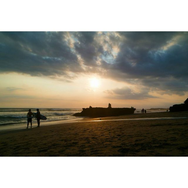 Sunset at Canggu beach The sun goes down and surfershellip